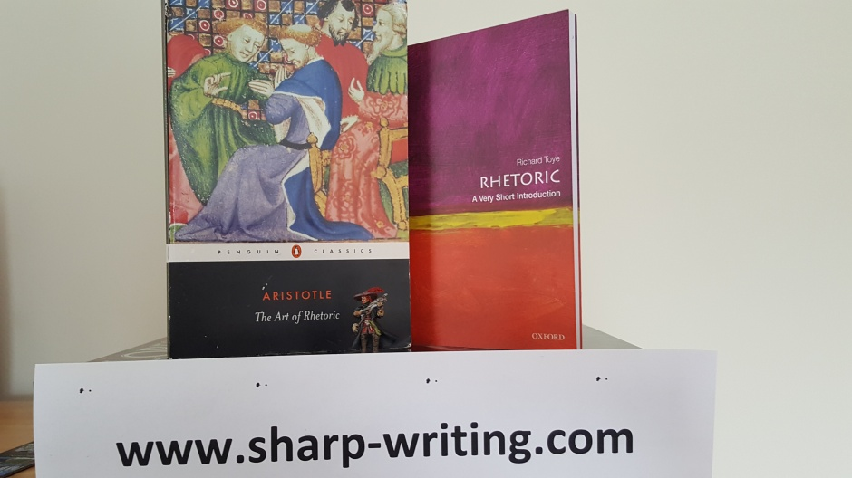 The Rhetoric by Aristotle, and intro to Rhetoric and a descent miniature being used as proxy for porthos